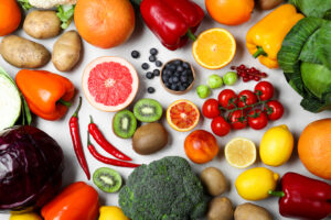 Fresh products rich in vitamin C on light table, flat lay
