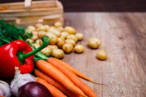 Natural organic bio food. Wooden basket on rustic table.
