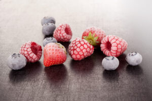 Delicious berries. Frozen strawberries, blueberries and raspberries.