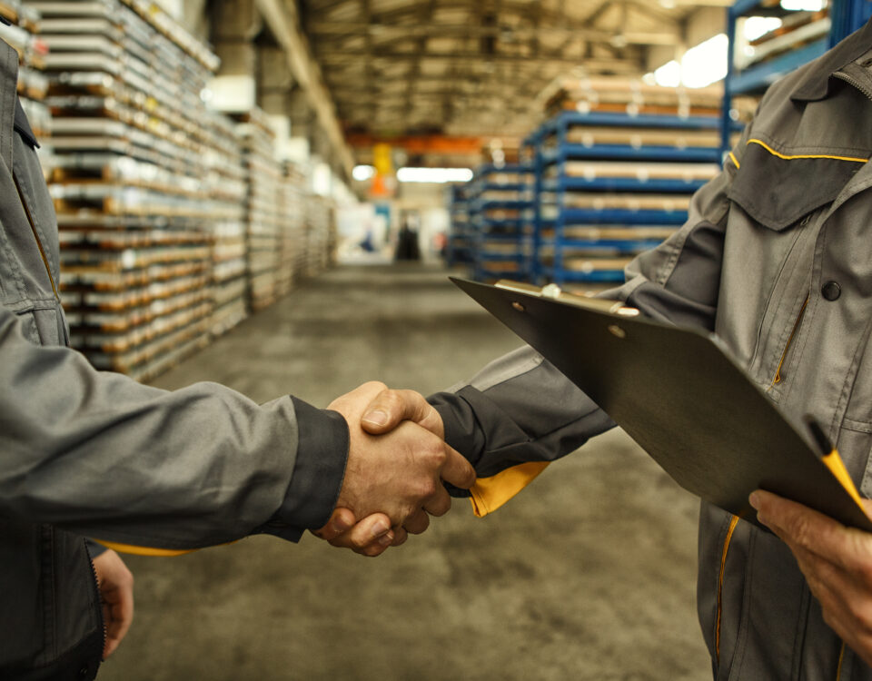 men shaking hands and making business deal with a co-packer